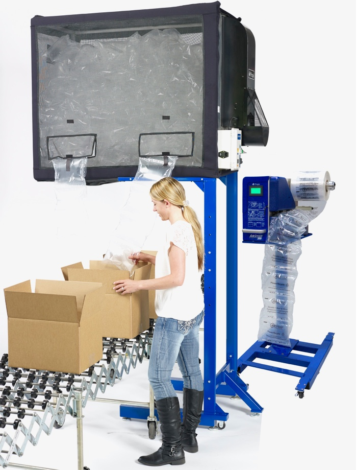 Employee using machinery to package goods.